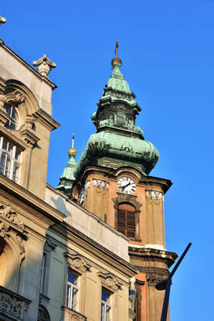 University Church baroque belfry in Budapest at dawn, with its typical spire made in 1771