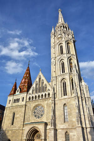 Matthias Church built in beautiful gothic style in the historic center of Budapest, at sunset.