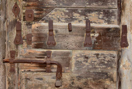 torn metal: Old lock with rust, keyhole and padlock Stock Photo
