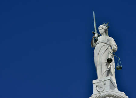 justice statue: Goddess of Justice statue with scales and sword, at the top of Doge Palace in Venice (with copy space) Stock Photo