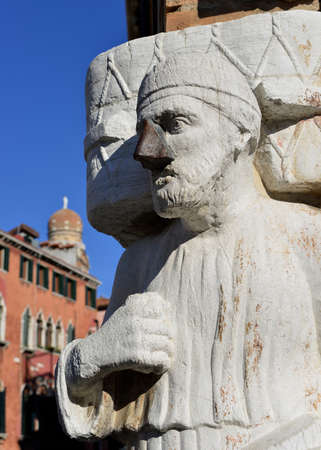the merchant of venice: Moorish merchant Sior Rioba medieval statue in Venice, with iron nose Stock Photo