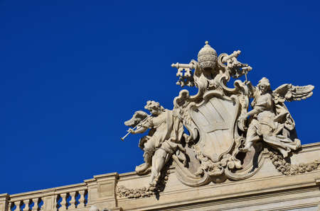 angels fountain: Emblem of Pope Clement XII between angels with trumpets, at the top of the beautiful Trevi Fountain in Rome (with copy space) Stock Photo