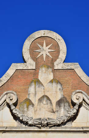 House of Chigi noble roman family emblem with mountains and star, at the top of Peoples Square main gate in Rome (17th century)