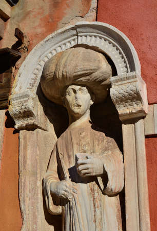 the merchant of venice: Muslim merchant medieval statue near Moorish Square in Venice
