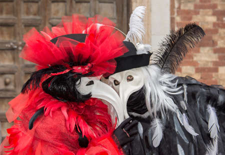 grotesque: Venice, Italy, February 2, 2016: Carnival of Venice two grotesque masks