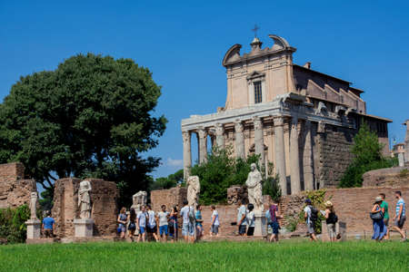 vestal: Rome, Italy, September 4, 2016: Tourists visit House of the Vestal ruins and Temple of Antoninus and Faustina in the Roman Forum