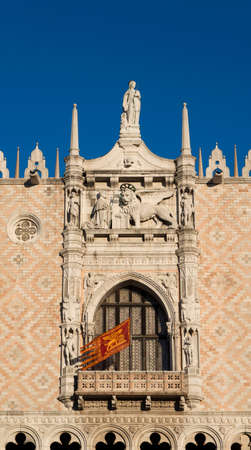 Doge Palace beautiful renaissance balcony with old Venice Republic flag and Saint Mark Lion Stock Photo