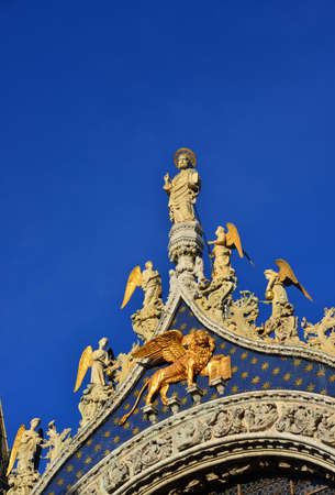 Saint Mark Basilica top statues shines like gold at sunset in Venice (with copy space) Stock Photo
