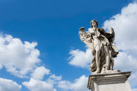 Angel statue with garment and dice on Castel SantAngelo Bridge, with heavenly sky and copy space
