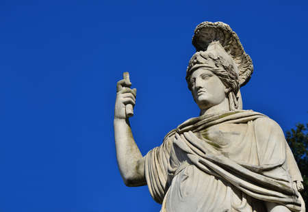 Minerva as Goddess Roma neoclassical old marble statue in Peoples Square in Rome (with copy space)