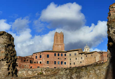 Ancient Tower of the Militia built over Trajans Market in the Middle Ages, viewed from Imperial Forum ruins in Rome Stock Photo