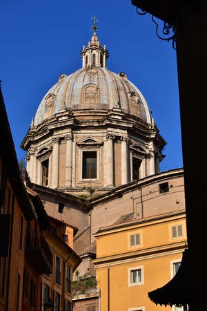 maderno: SantAndrea della Valle (Saint Andrew) beautiful baroque dome in Rome, completed by famous architect Carlo Maderno in 1608, viewed from historic center narrow street