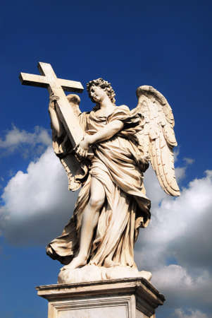 Angel holding Holy Cross statue, a 17th century baroque masterpiece in Rome Stock Photo
