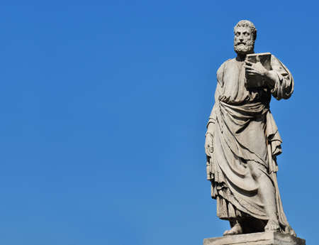Saint Peter holding the key of heaven statue on Holy Angel Bridge in Rome, made in the 17th century by sculptor Lorenzetto (with copy space) Stock Photo