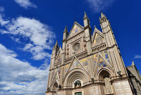 architecture monumental: Beautiful gothic Orvieto Cathedral in Umbria, Italy, with clouds Stock Photo