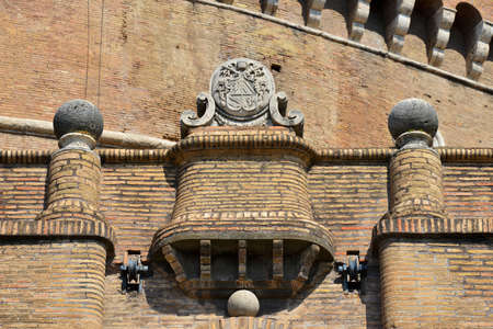 Pope Pius IX heraldic emblem on Castle of Holy Angel defensive walls in Rome , among three ancient cannonballs
