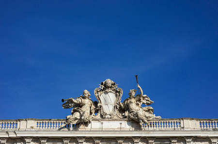 Pope Clement XII emblem between two angels statues with trumpets in Quirinal Square in Rome, designed by italian architect Ferdinando Fuga in the 18th century (with copy space)