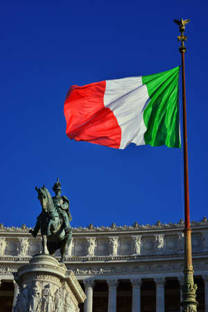King of Italy looks at the Italian Flag at the Altar of Nation monument, in the center of Rome Banque d'images