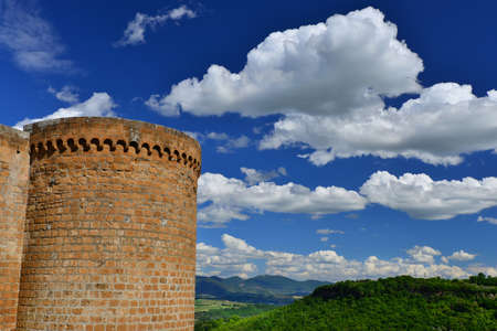 Orvieto ancient medieval city walls with round tower and countryside panorama Stock Photo