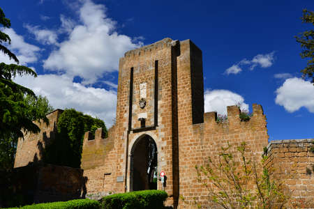 Entrance of the medieval Albornoz Fortress in the historic center of Orvieto, an ancient papal fort and now the ciy public park Editorial