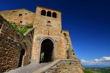 Civita di Bagnoregio the town that is dying medieval historic center ancient gate Editorial