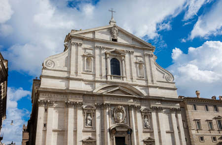 Church of the Most Holy Name of Jesus mannerism and baroque church facade with beautiful clouds in the historic center of Rome