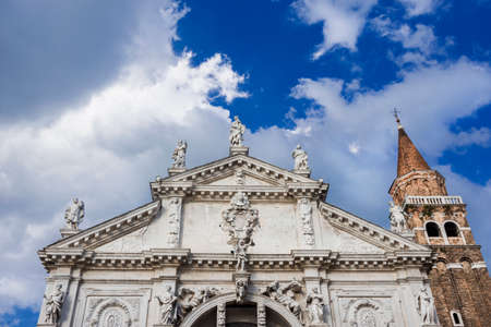 Saint Moses Church magnificent monumental baroque facade in Venice, completed in 1688, with prophet statues at the top and beautiful clouds