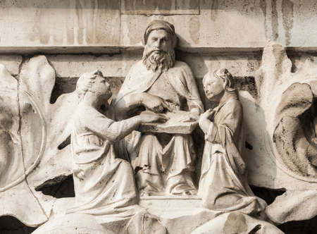 Moses teach Israelites the Law of God, ancient medieval relief on Venice Doge Palace column