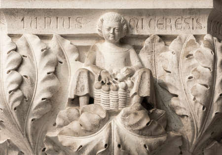 Peasant with cherries basket symbolizes the month of June, ancient medieval, relief on Venice Doge Palace column