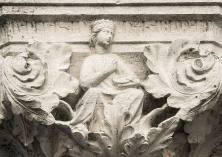 Queen, Princess or Damsel with tambourine, ancient medieval relief on Venice Doge Palace column
