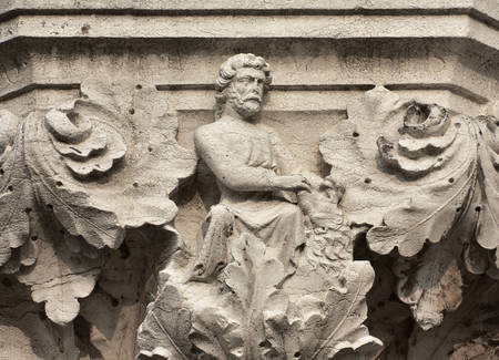 Hercules fight with Nemean Lion symbolizes strength, ancient medieval relief on Venice Doge Palace column Editorial