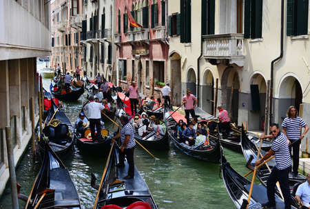 Venice, Italy, August 1, 2015: Gondola full of tourists blocked in traffic jam
