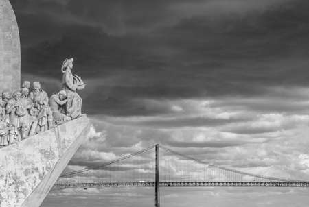 National Monument to the Discoveries along Tagus River and iconic Lisbon bridge in the background (Black and White)