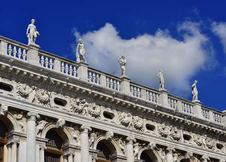 Monumental balustrade with statues of Saint Mark Library in Venice, designed by the famous renaissance architect Sansovino in the 16th century