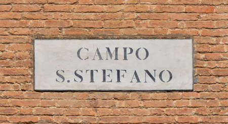 characteristic: Campo Santo Stefano (Saint Stephen Square) old characteristic road sign in the historic center of Venice