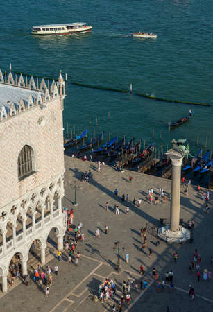 Venice, Italy, June 15, 2017: Saint Mark Square and Venice Lagoon with tourists, monuments and gondolas seen from above