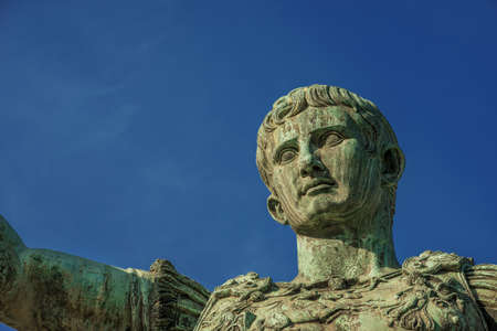 Caesar Augustus, first emperor of Ancient Rome. Old bronze statue in the Imperial Forum, seen from below