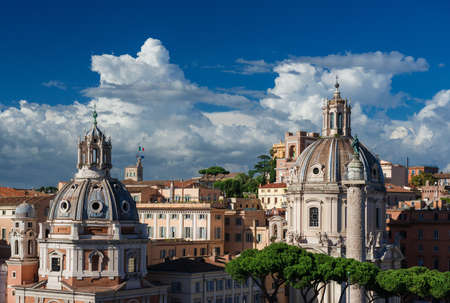 Rome historical center skyline with ancient domes, Trajan Column and Quirinal Hill