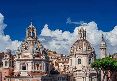 Twin Churches beautiful domes with ancient Trajan Column and clouds