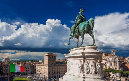 Rome historic city center with Italian Flag and beautiful clouds panoramic view from Altar of Nation Monument Stock Photo