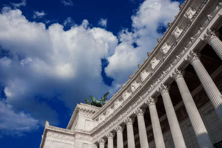 National Monument to Victor Emmanuel II first King of Italy (Altar of Nation), a neoclassical structure designed by italian architect Sacconi in 1885, with blue sky and clouds Banque d'images
