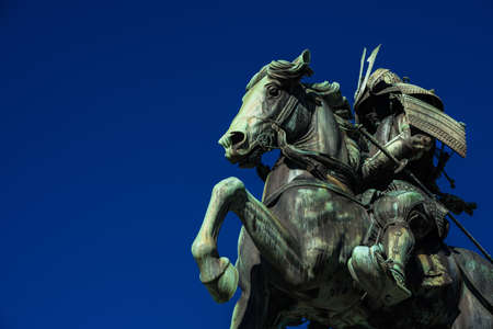Kusunoki Masashige samurai bronze equestrian statue erected in 1897 in the center of Tokyo (with copy space) Banque d'images