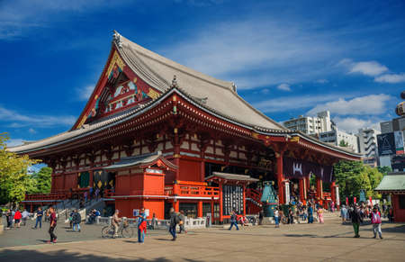 Tokyo, Japan, October 18, 2017: Tourists visit old Senso-ji Buddhist Temple during the Golden Dragon Dance Festival in Asakusa Editorial