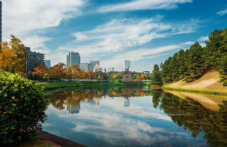 View of the Tokyo city center from the Imperial Palace public gardens ancient moat in autumn Reklamní fotografie