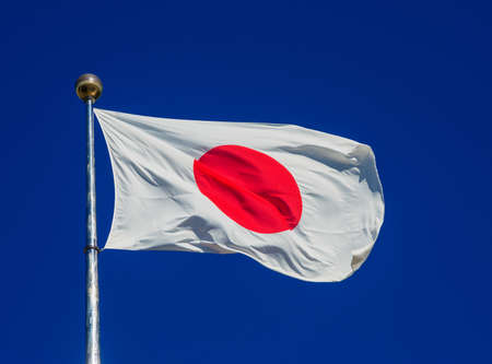 National Flag of Japan with the Red Sun waving in the wind