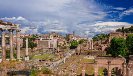 Roman Forum ancient ruins panoramic view with clouds from Capitoline Hill in the historic center of Rome