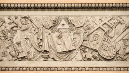 Christian religious symbols with the eye of providence on a 19th century relief in Rome Peoples Square