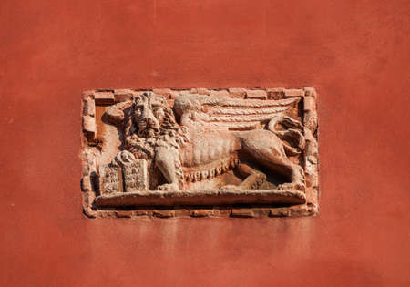 Saint Mark Winged Lion old relief on a venetian wall, symbol of the ancient Republic of Venice