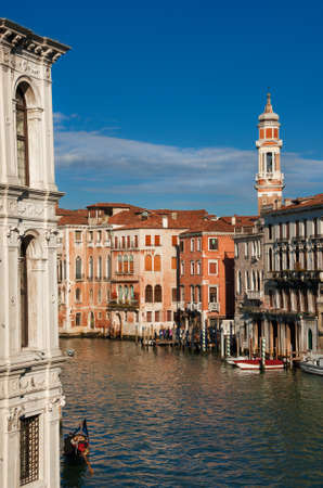 Grand Canal view from Rialto Bridge with gondola and old bell tower in Venice Banque d'images