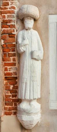Marchand maure avec turban ancienne statue médiévale à Venise